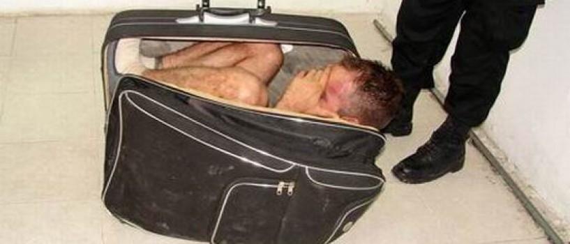 A incercat sa-si scape sotul din inchisoare, inghesuindu-l intr-o valiza!