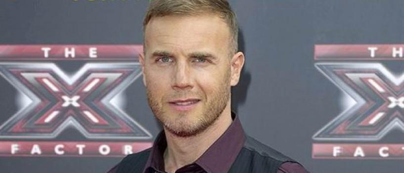 Gary Barlow a ajutat o concurenta X Factor in varsta de 70 de ani sa ajunga acasa!